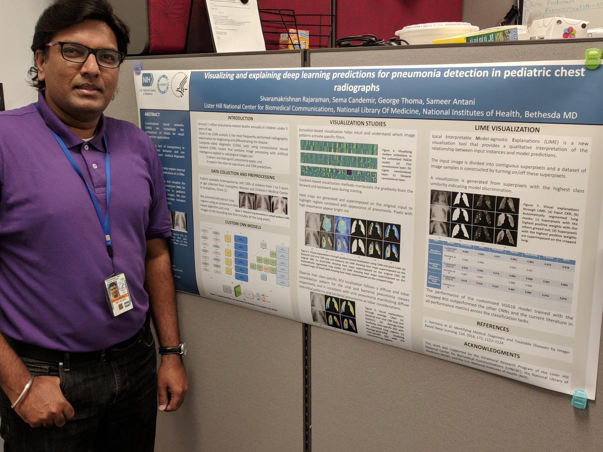 Dr. Sivarama Rajaraman in front of his poster